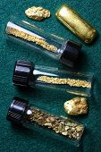 stock photo of gold panning  - Vials of natural gold dust and placer gold nuggets - JPG