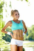 stock photo of spandex  - An attractive female runner stretching before her workout - JPG