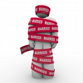 An unhappy man is wrapped in red tape with the word Married to illustrate being trapped or caught in an unhappy, unsuccessful marriage with no way out