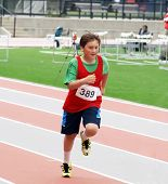 stock photo of track field  - Boy on the track and field competition