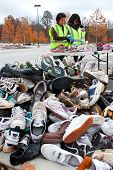 Teen Volunteers Sort Through Sneakers At Recycling Event