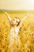 Little Girl Among Wheat Ears