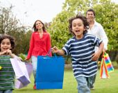 Family With Shopping Bags Outdoors