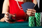pic of gambler  - A female gambler with cards and a glass of whiskey - JPG