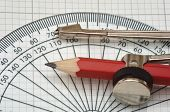 pic of protractor  - plastic protractor and compass on graph paper - JPG