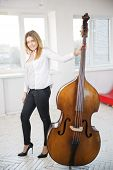Woman With Contrabass At Sunny Day