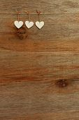 White Love Valentine's Hearts Hanging On Wooden Texture Background