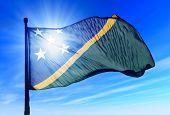 Solomon Islands flag waving on the wind