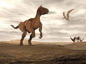 stock photo of pteranodon  - Beautiful velociraptor dinosaur in desertic landscape with two pteranodon bird by cloudy sunset - JPG