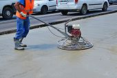 stock photo of trowel  - Helicopter concrete finishing - JPG