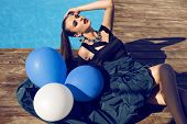 Fashion Model In Luxury Dress Posing With Balloons