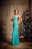 Luxury blonde in interior New Year. Young beautiful trendy girl celebrating Christmas. The friendly