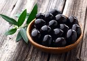 Olives on a wooden background