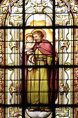 PARIS,NOV 07:St. Joseph holding baby Jesus, stained glass, church of St. Elizabeth is situated in th