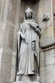 PARIS, FRANCE - NOV 11, 2012: Saint Bathilde statue, Church of St-Germain-l'Auxerrois founded in the