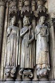 PARIS, FRANCE - NOV 11, 2012: Medieval Gothic statues on entry to Church of St-Germain-l'Auxerrois f