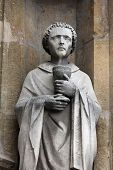 PARIS, FRANCE - NOV 11, 2012: Saint Cloud statue, Church of St-Germain-l'Auxerrois founded in the 7t