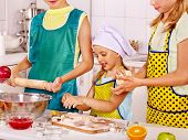 Children bake cookies at  kitchen.