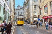 LISBON, PORTUGAL -APRIL 19, 2014: Very touristic place in the old part of Lisbon, with a traditional
