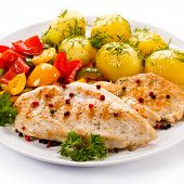 Grilled chicken fillet, boiled potatoes and vegetables