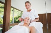 Peaceful brunette getting micro dermabrasion in the health spa