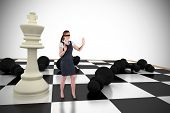 Redhead businesswoman in a blindfold with chessboard against white background with vignette