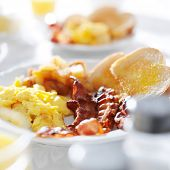 stock photo of hash  - scrambled eggs and bacon breakfast meal - JPG