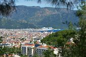 MARMARIS, TURKEY - APRIL 17, 2014: Cityscape of Marmaris with the cruise liner AIDAdiva anchored in