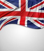Closeup of Union Jack flag on plain background