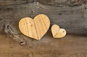 Two Love Valentines Wooden Hearts On Old Elm Background