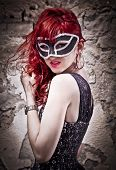 Masquerade. Beautiful girl in a carnival mask. Bokeh