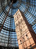 MELBOURNE, AUSTRALIA - JULY 3  2014: Melbourne's Shot Tower which was built on the site in 1888 is an iconic building contained underneath a massive glass dome at the Melbourne Central shopping centre
