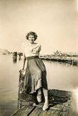 HAMBURG, GERMANY, CIRCA JULY 1950 - Vintage photo of woman in port