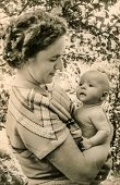 GERMANY, CIRCA THIRTIES - vintage photo of mother and baby
