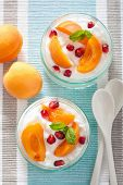 healthy breakfast with yogurt apricot pomegranate