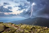 thunderstorm with lightening and dramatic clouds in Carpathian mountains
