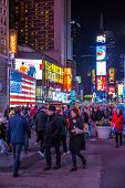 New York City -April 8: Times Square, featured with Broadway Theaters and animated LED signs, is a s