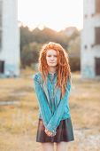 image of dread head  - Young pretty stylish girl with dreadlocks outdoors - JPG