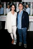 EAST HAMPTON, NEW YORK-JULY 6: Haley Binn (L) and husband Jason Binn attend the premiere of
