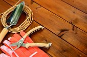 Close-up gardening tools and objects on old wooden background with copyspace
