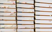 stack of books with sticky notes
