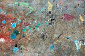Concrete floor with multicolored paint stains