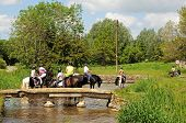 Horse riding along river, Lower Slaughter.