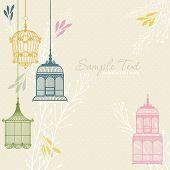 card with vintage birdcage at beige background