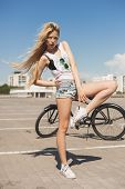 Young Woman With Bike Outdoors