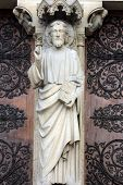 PARIS, FRANCE - NOV 05,2012: Christ Teaching, architectural detail of Notre Dame cathedral.Detail of