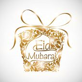 Golden floral decorated gift box on grey background for the occasion of Muslim community festival Ei