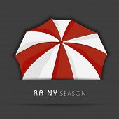 Stylish maroon and white umbrella on grey background for rainy season.