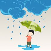 Heavy raining concept with cute little boy holding an umbrella on grey background.