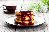 Delicious Pancakes With Raspberries Sauce On The Wooden Kitchen Table